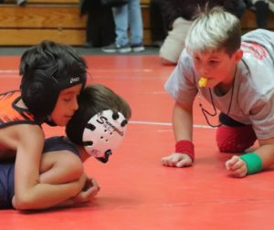 11-year-old referee Stephen Seymour judges a wrestling match. Photos by Robert Eliason.