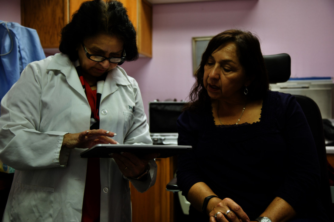 Dr Sharma (left) with Matilda Salicido, one of her patients for over 20 years. Photo by Leslie David