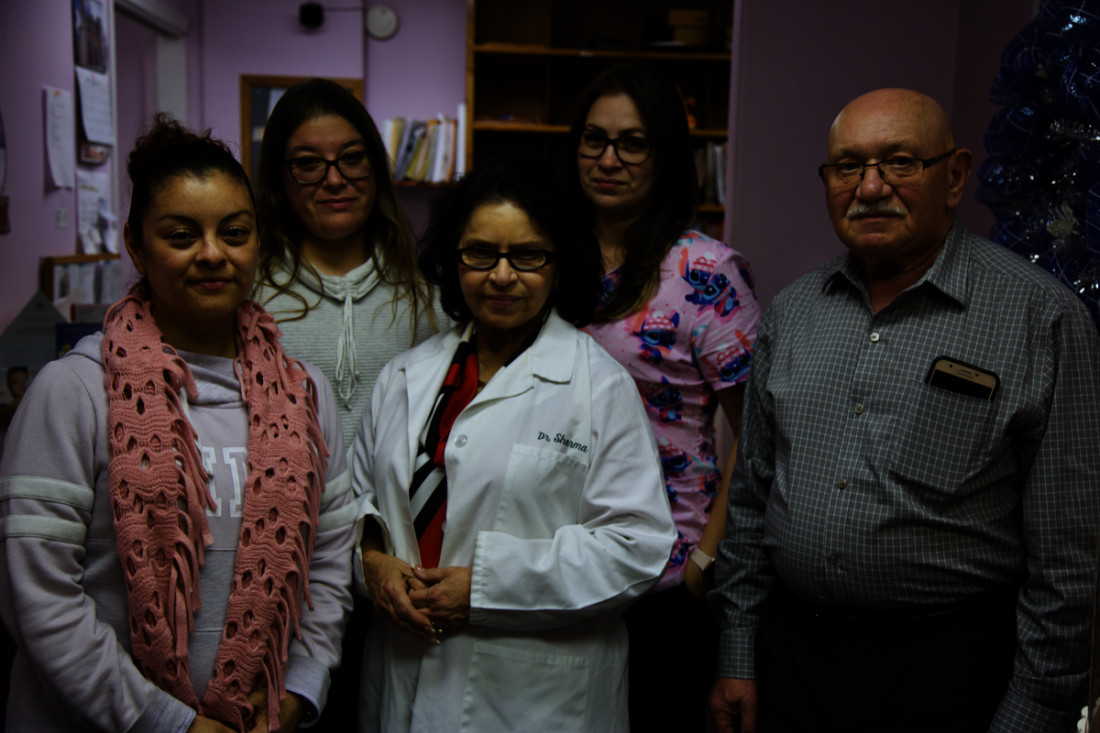 Group photo from Dr. Sharma's office: Vanessa Garcia, Linda Rodriguez, Cecelia Vasquez, Dr. Sharma and Henry Vinokurov. Photo by Leslie David.