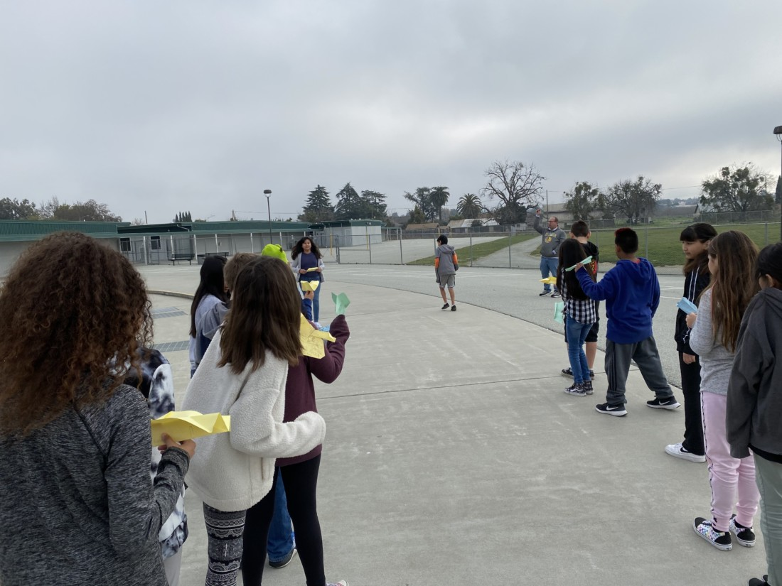 Ladd Lane fifth graders see how far their paper planes can fly.
