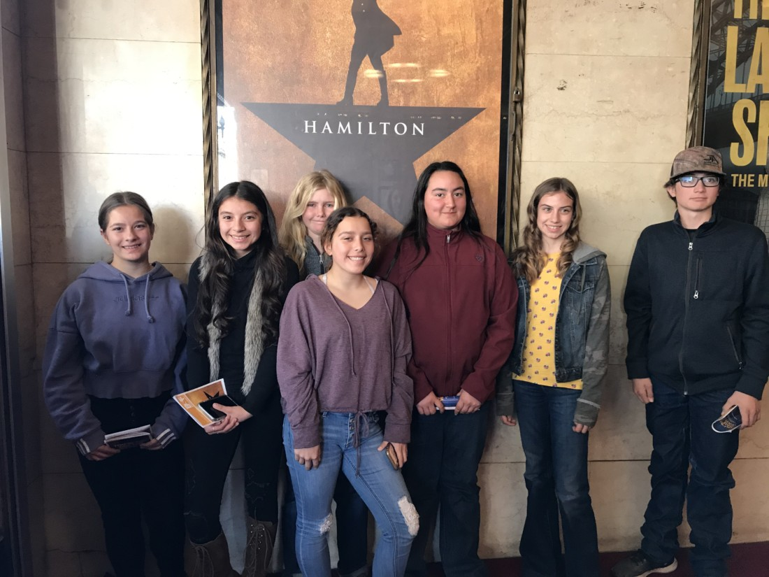Bitterwater-Tully students gather under the Hamilton poster in San Francisco. Photo by Gail Ivens.