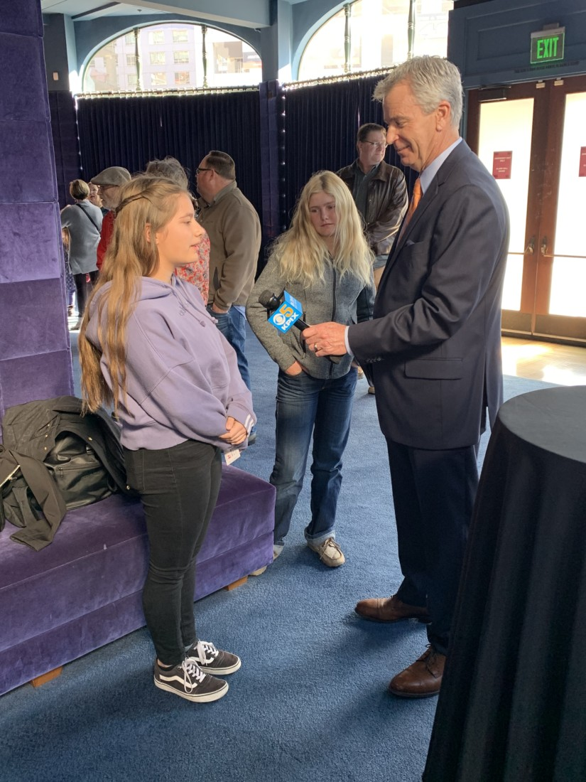 Olivia is interviewed by a CBS reporter. Photo by Gail Ivens.