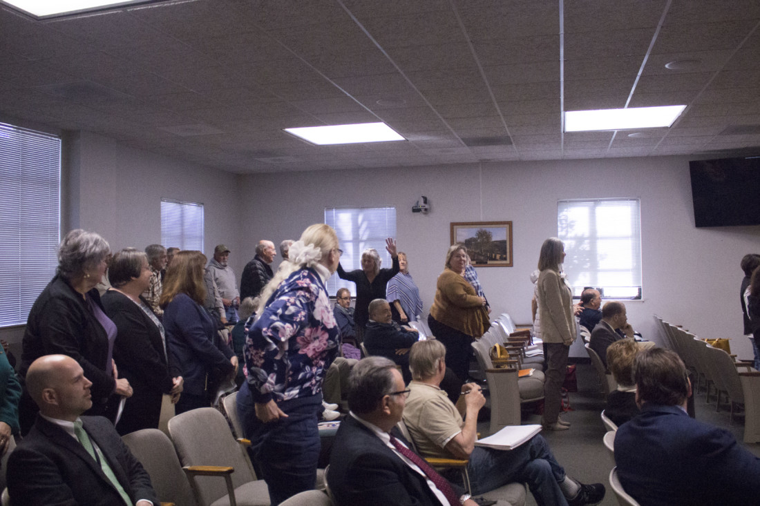 Retired San Benito County employees stand to show support for a petition requesting full health benefits and reimbursement at a Feb. 18, 2020 Board of Supervisors meeting. Photo by Noe Magaña.