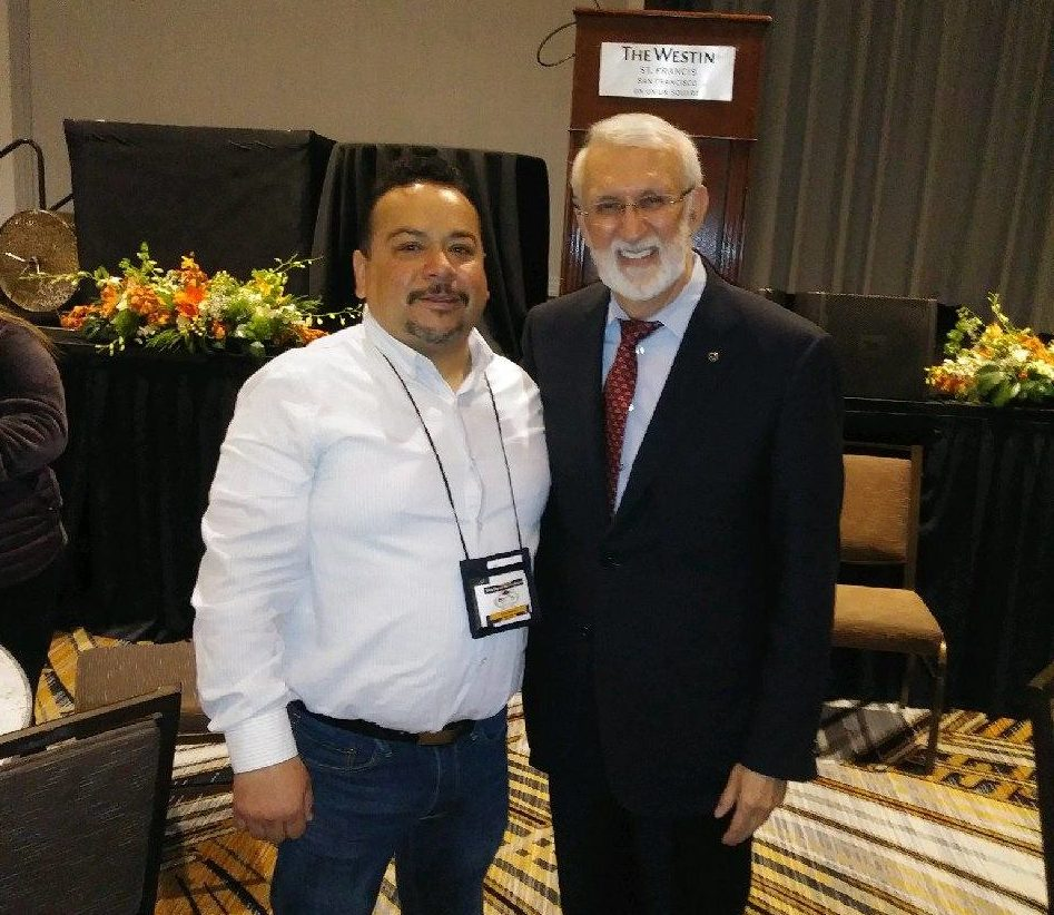 Julio Salazar at the State Migrant Parent Conference in 2016 with Dr. Sergio Aguilar-Gaxiola from UC Davis. Aguilar-Gaxiola is the director of UC Davis' Center for Reducing Health Disparities and professor of clinical internal medicine. Photo provided.