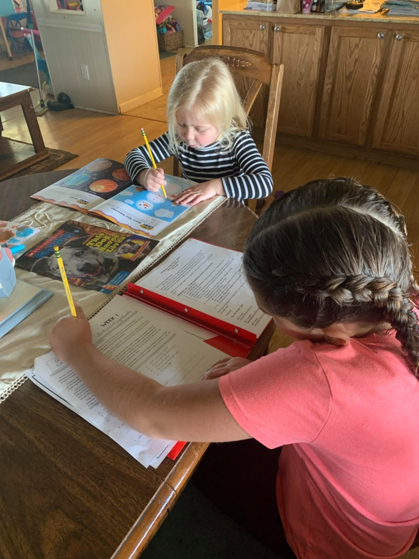 McKenna and Rylee working on school work at home. Photo provided.