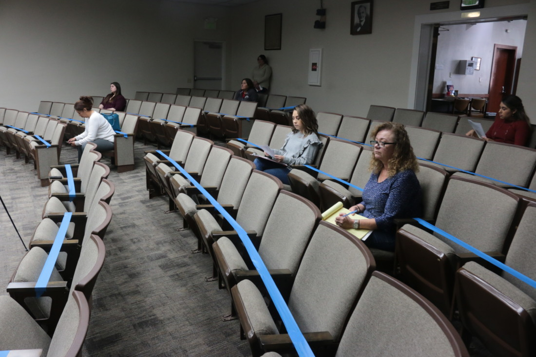 Most of the seats in the council chambers were taped off.
