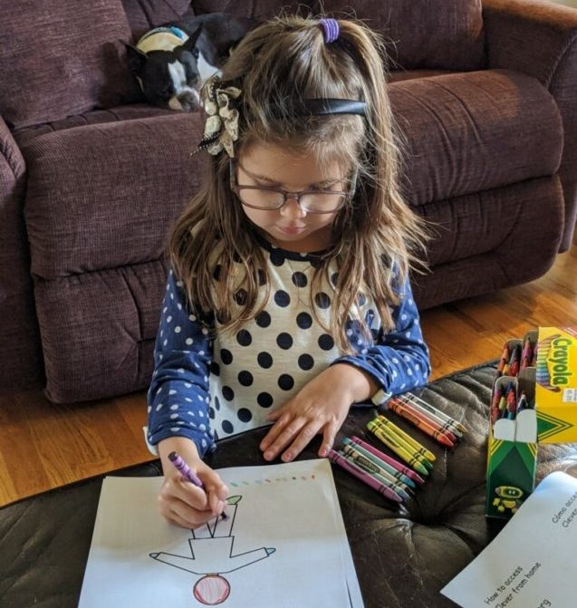 Caroline Perry, a student at Ladd Lane, working on school work at home. Photo provided.