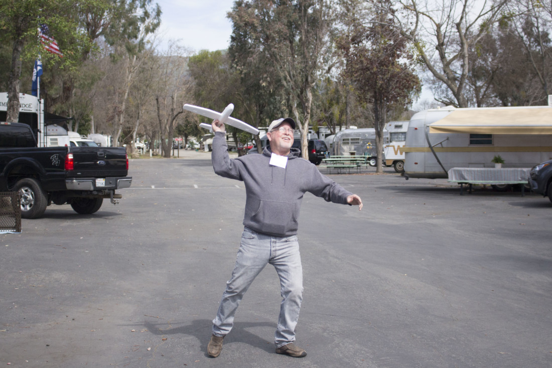 Tim Murray tries out his newly acquired $1 plane. Photo by Noe Magaña.