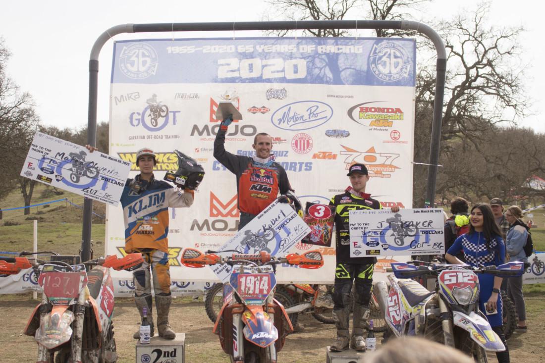 Top three finishers at the podium.