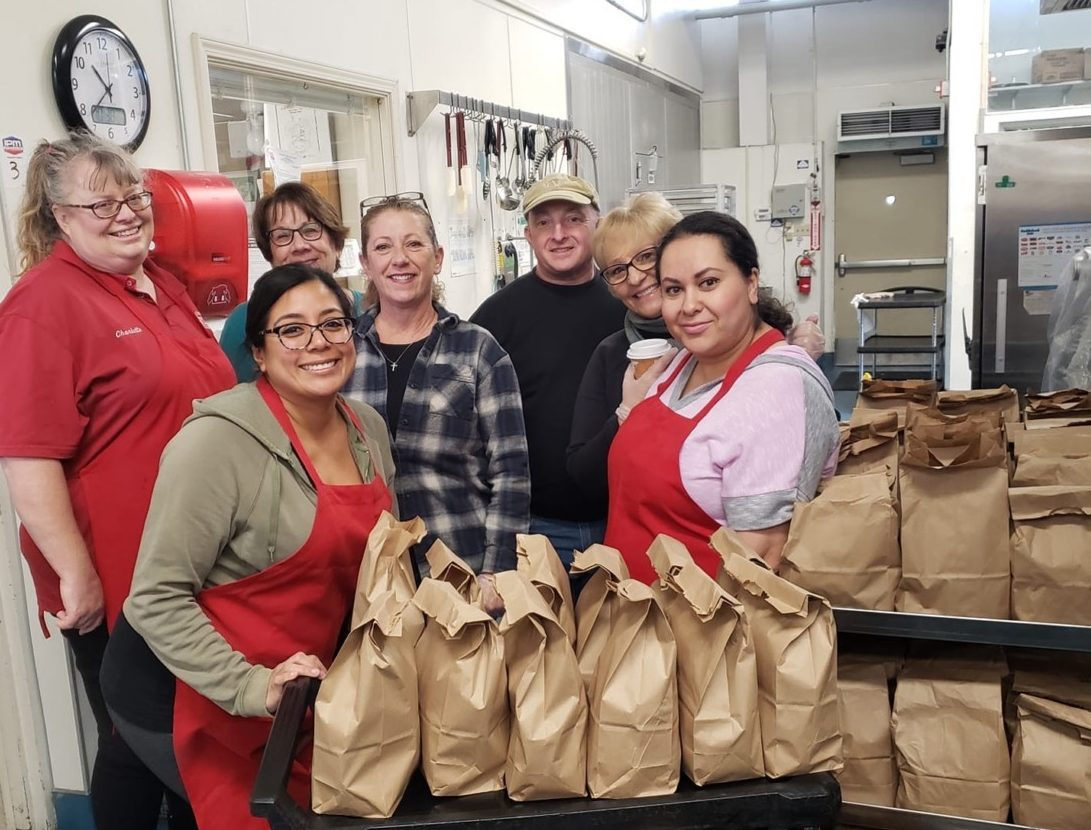 "When it came to making sure students would be able to eat during these challenging times, SBHS Food Service Coordinator Jim Lewis (back right) said, ""We were ready to do what we had to do. There was no question that these kids were going to be fed."" Photo provided by Tina Talavera."