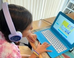 From 11 a.m. to noon, Bella works on apps online. Photo by Patty Lopez Day.