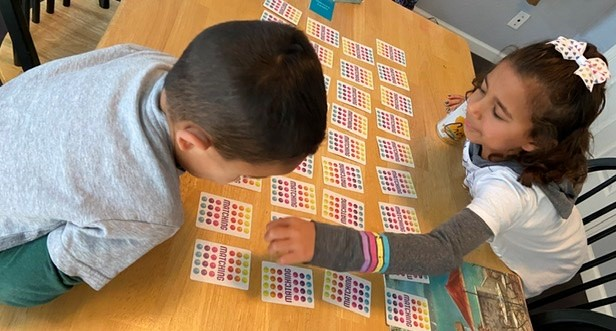 From 4-5 p.m., our schedule includes free time. Here we engage in a family game of matching. Photo by Patty Lopez Day.