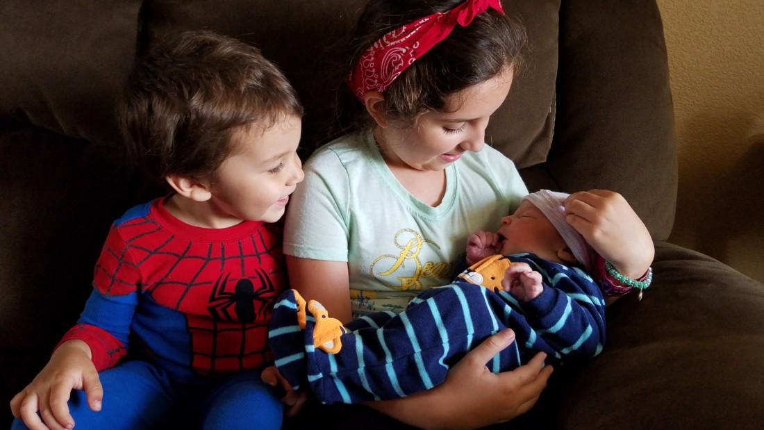 Noah and Melia Magaña meet their newborn brother, Nathan.