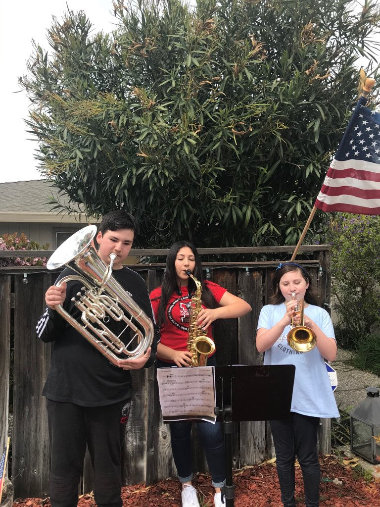 Tristan, Brianna, and Megan Phillips play music each night for the neighborhood. Photo provided.