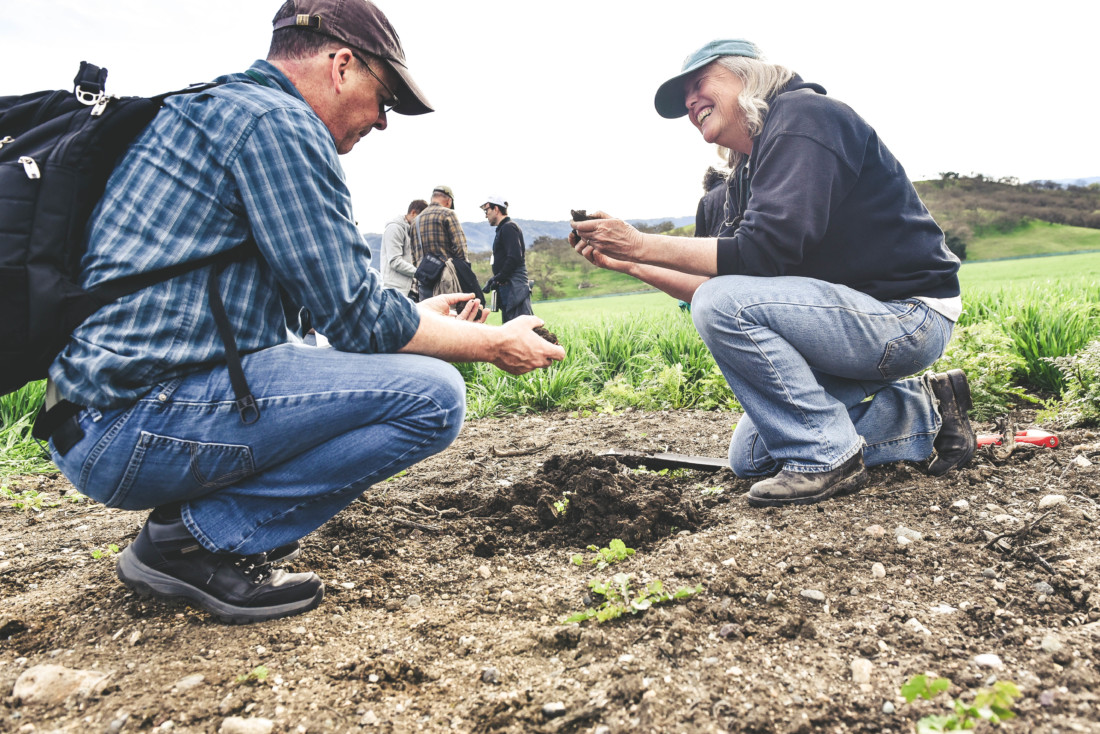 Sallie Calhoun (right) talks soils with a Paicines Ranch workshop guest. Photo by Alicia C Arcidiacono.