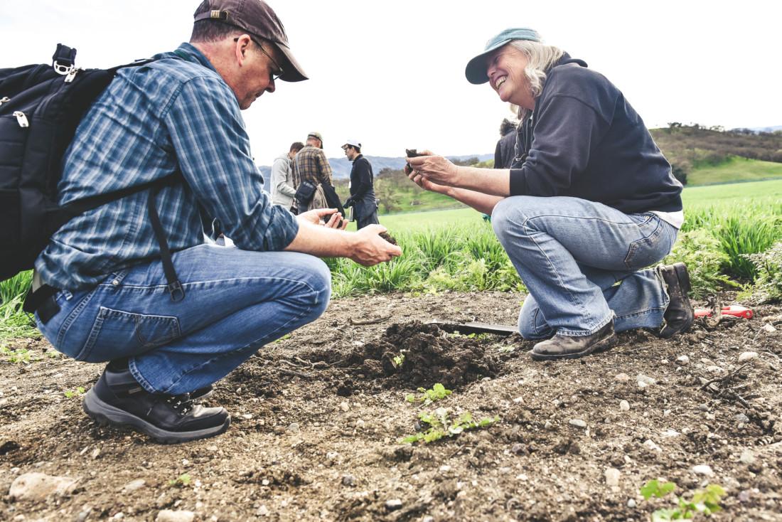 Sallie Calhoun (right) talks soils with a Paicines Ranch workshop guest. Photo by Alicia C Arcidiacono.