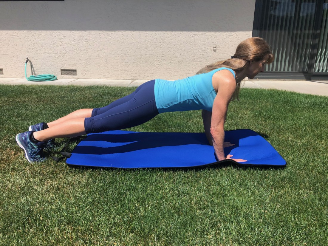 Mary Margaret Lanning, creator and owner of Overall Fitness and Nutrition, demonstrates a straight arm plank. Photo courtesy of Mary Marguerite Lanning.