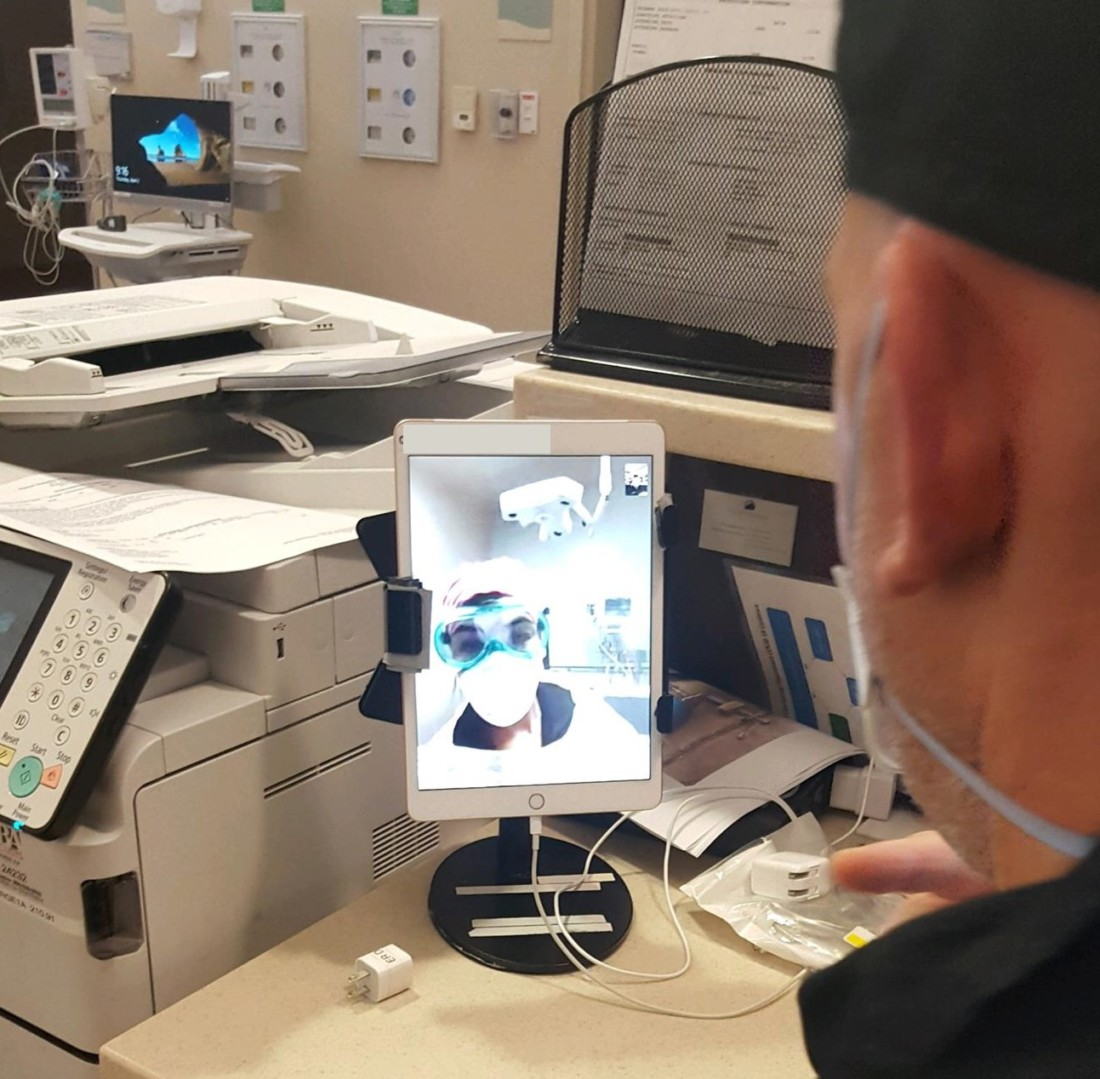 Video conference between ER physician and nurse in room with patient. Photo provided by HHH.