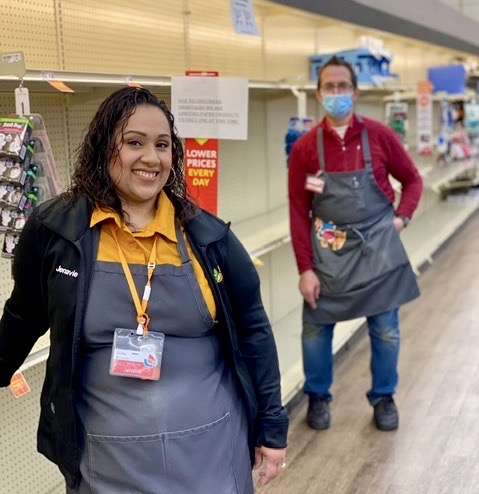 Jenavie Hernandez stands by empty shelves with supervisor Chris Tanzi. Photos provided by Alex Esquivel.