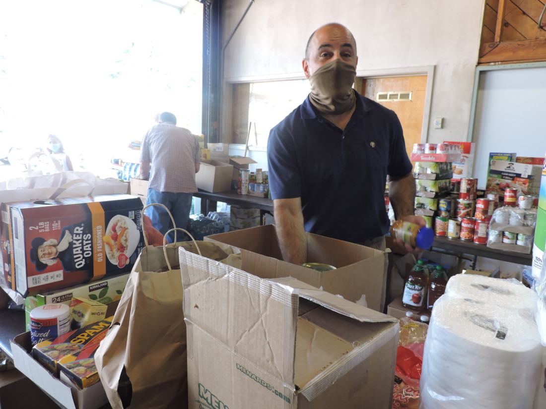 Congressman Jimmy Panetta sorts donated goods. Photo by Patty Lopez Day.