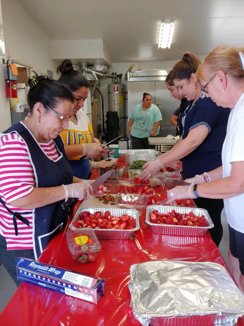 Volunteers prepare food at last year's event. Photo provided.