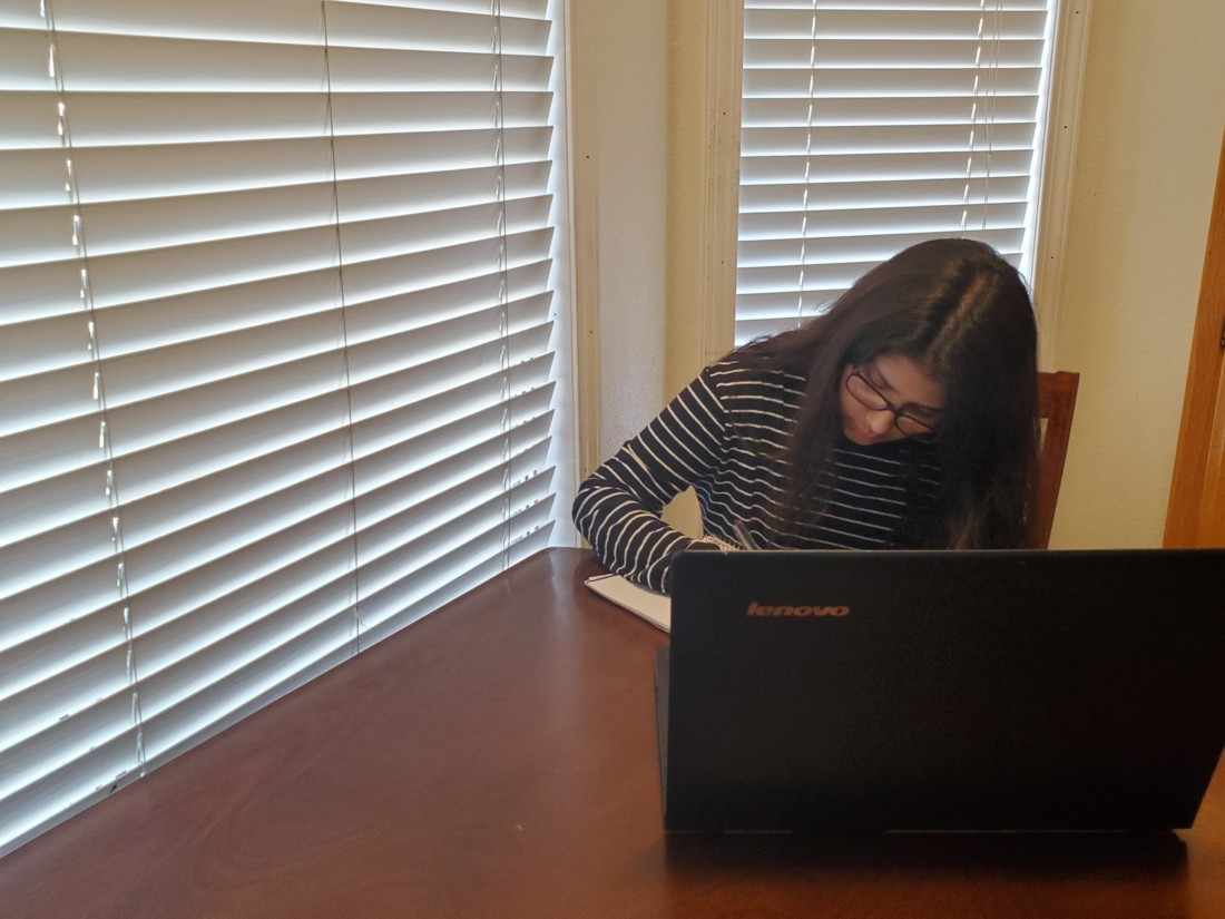 San Benito High senior Victoria Flores working on school assignments at home. SBHS started its online distance learning on March 30. Photos provided by Victoria Flores.
