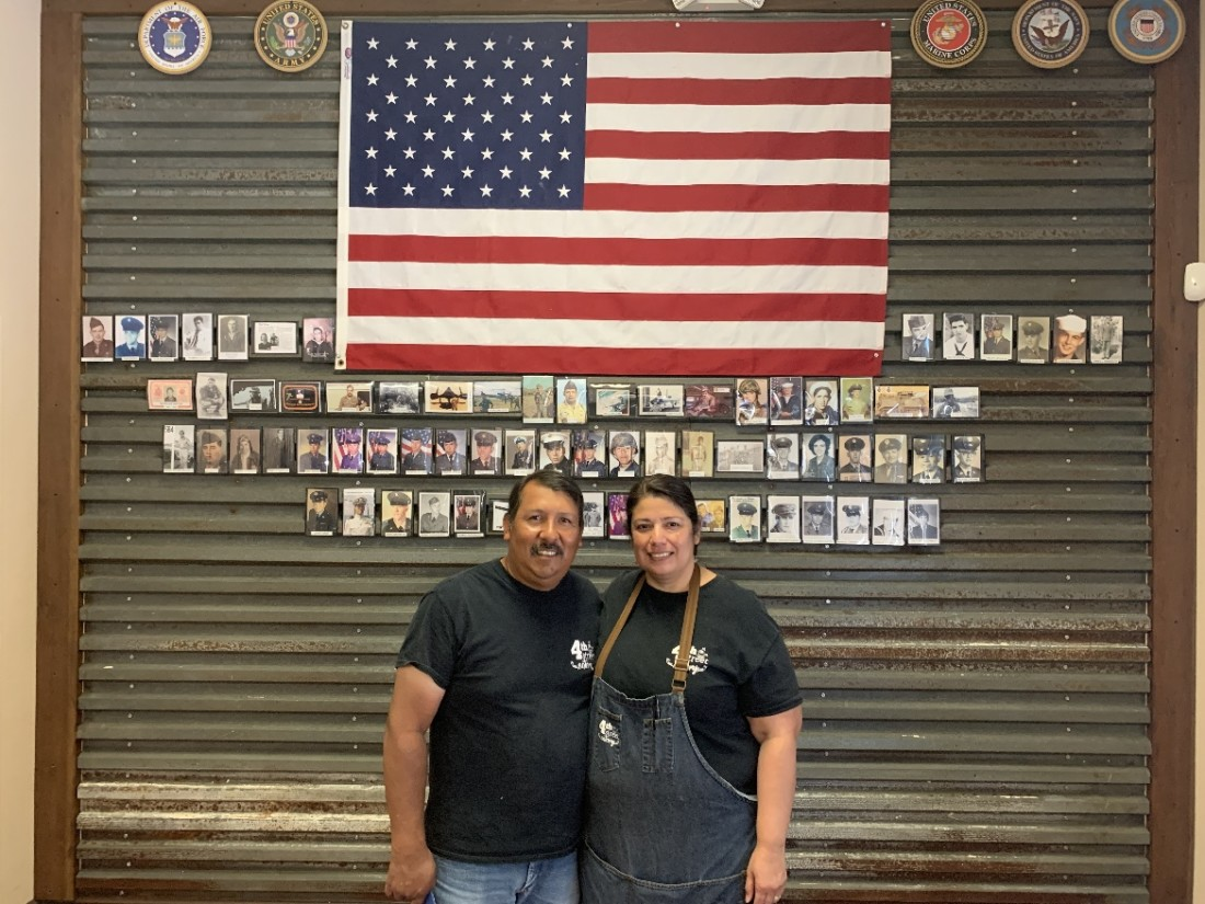 Mark and Jeanette Pulido at the Memorial Wall in 4th Street Eatery. Photos by Robert Eliason.