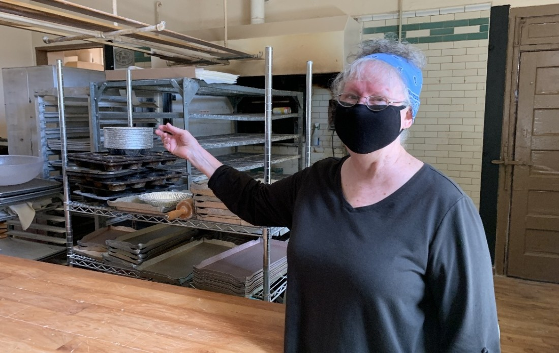 Bakery owner Dianne Hampton and oven in the background. Photo by Robert Eliason.