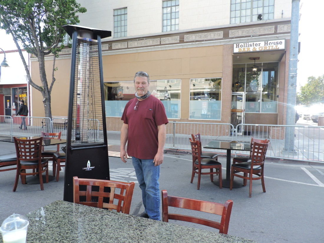 Hollister House owner Jack Barbieri stands inside his outdoor seating area in front of his restaurant.