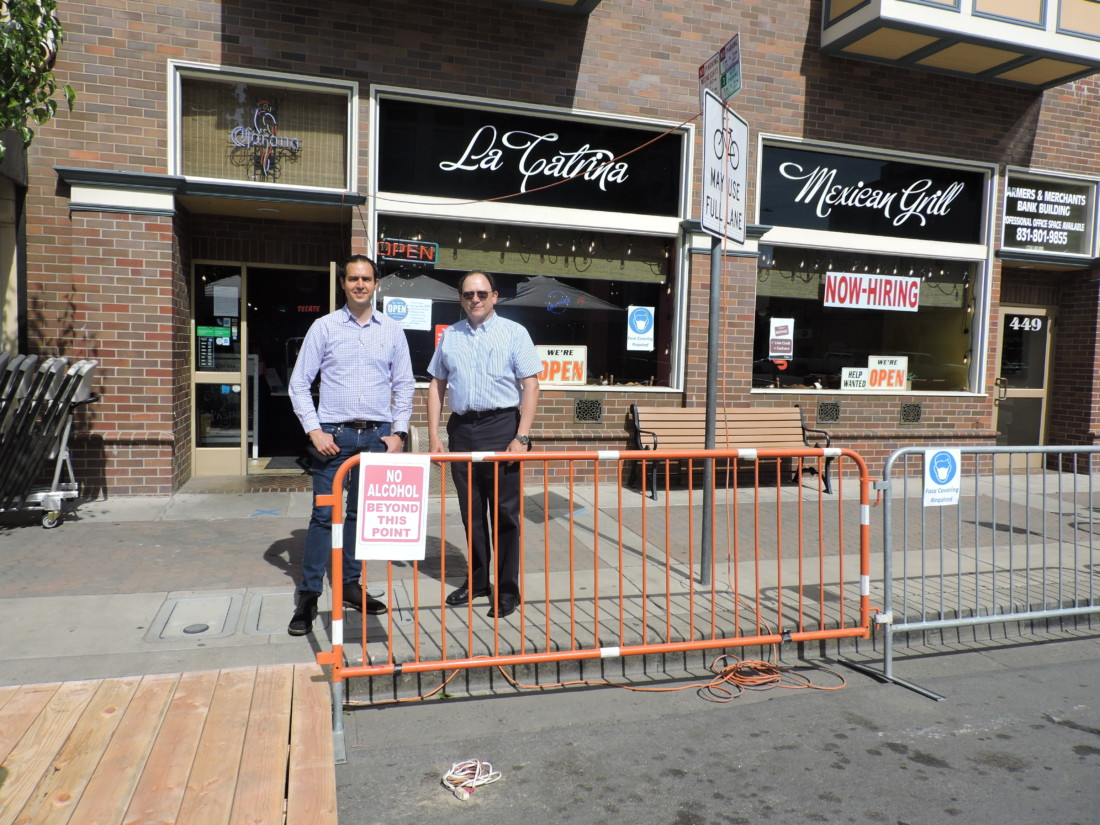 La Catrina General Manager Gustavo Gonzalez Jr. stands at the entrance to their outdoor seating with owner Gustavo Gonzalez Sr.