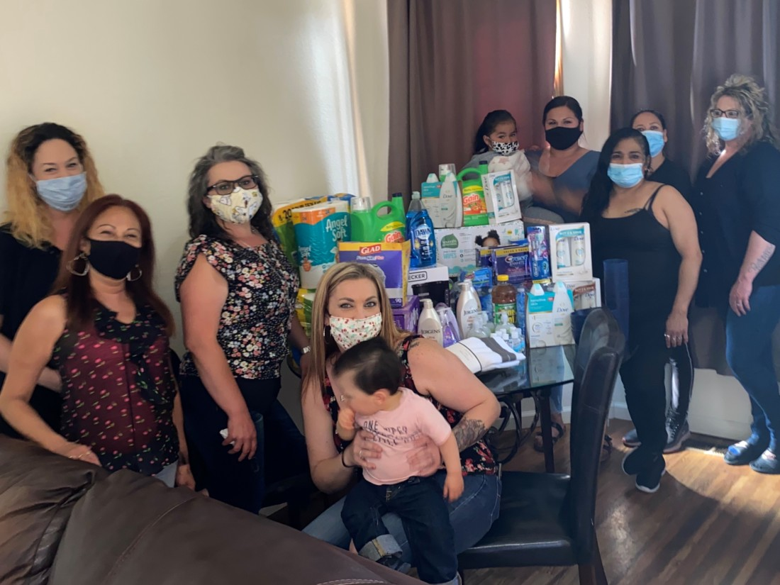 """Sun Street Centers clients with items purchased on a recent shopping run that includes cleaning supplies and other essentials. """"It is exciting for our clients to have essential items during this time, this helps them maintain or helps them move forward in their personalized programs,"""