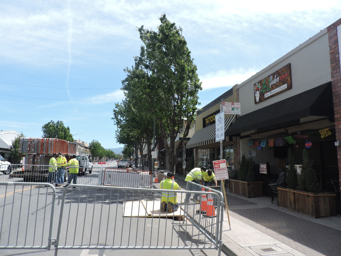 City workers set up the outdoor dining areas.