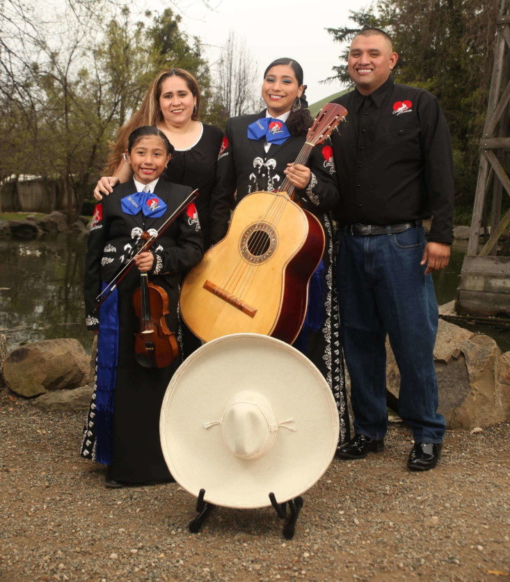 Mariachi Juvenil Corazón Jalisciense Director Israel Ramirez with his wife Carmen and daughters Carmen, 14, and Miriam, 8. Photo provided.