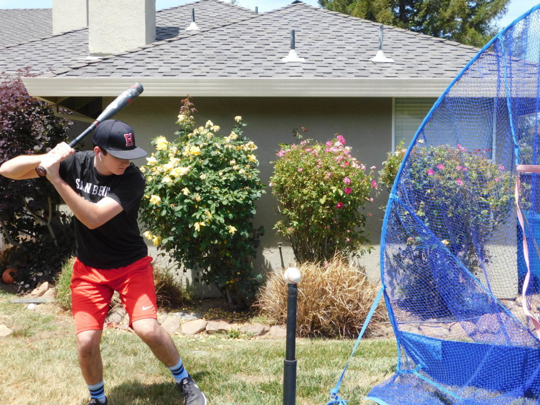 San Benito High senior Nicolas Skardoutos, who is going to University of La Verne to play baseball, practicing in his backyard. Photo provided.