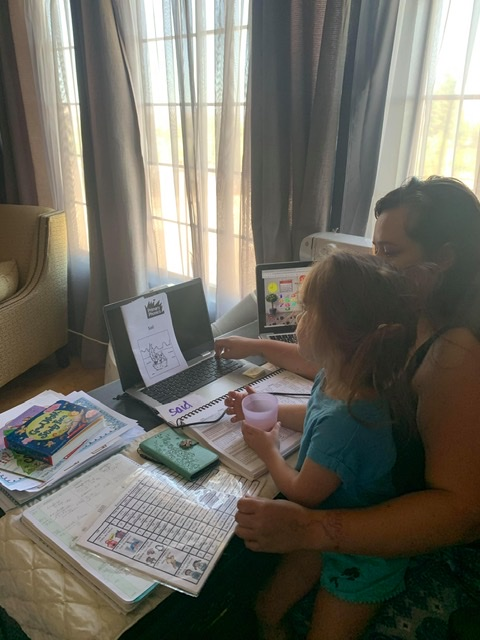 Maze Middle School English teacher Sara Casillas works on her fall lesson plans while caring for her 4-year-old niece. Photo provided.