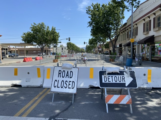 Road closed and detour signs allow for some traffic to divert to the side alley. Photo by Patty Lopez Day.