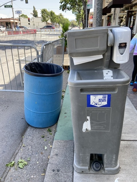 Hand washing stations are placed strategically throughout the street closure for outdoor dining. Photo by Patty Lopez Day.