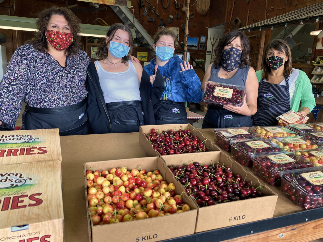 Marie Hoffman, Grace Gillio, Emma Hoffman, Julie Gillio and Nicole Rajkovich show off their yellow and red Rainier and Bing cherries. Photo by Leslie David.