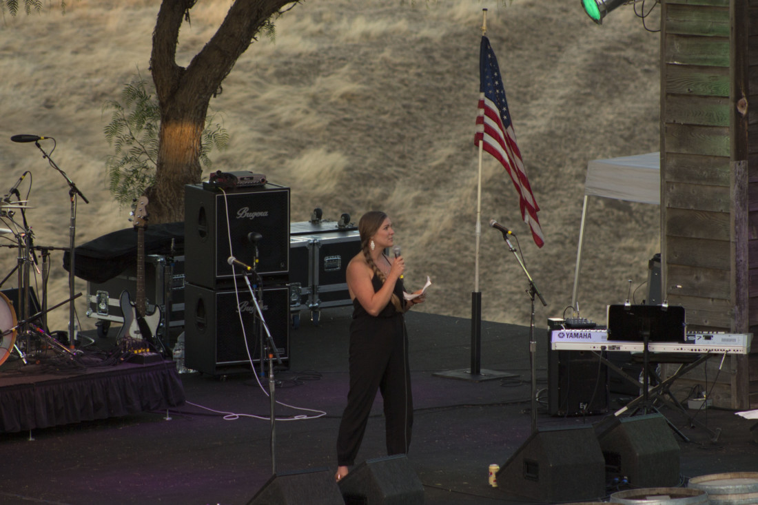 Courtney Evans urging attendees to get involved in local government. Photo by Noe Magaña.