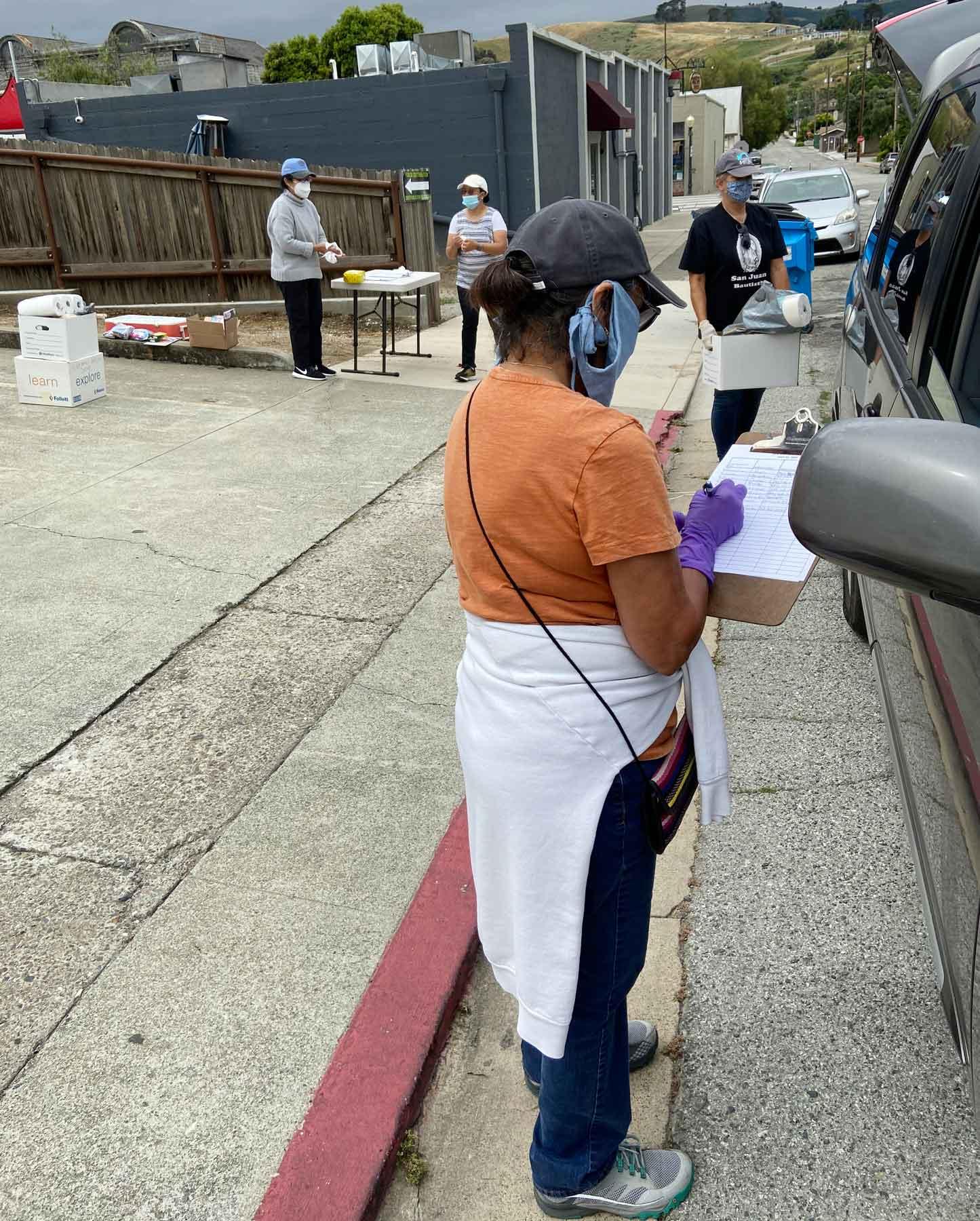 San Juan Mayor Mary Vazquez Edge taking down information. Photo provided by Kollin Kosmicki.