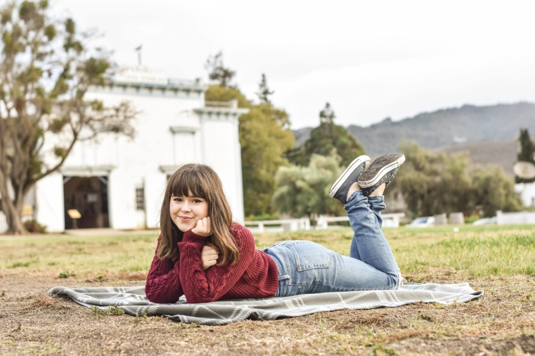 Aislinn Barnes posing for a photo at the plaza at Mission San Juan Bautista. Photo courtesy of Aislinn Barnes.