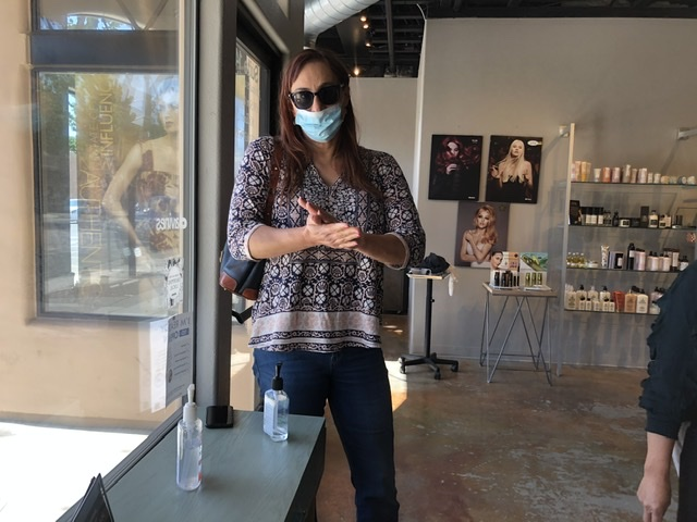 Rachel Masters came in when salons were allowed to reopen inside following procedures in place by owner. Photo courtesy of Cathleen Scott.
