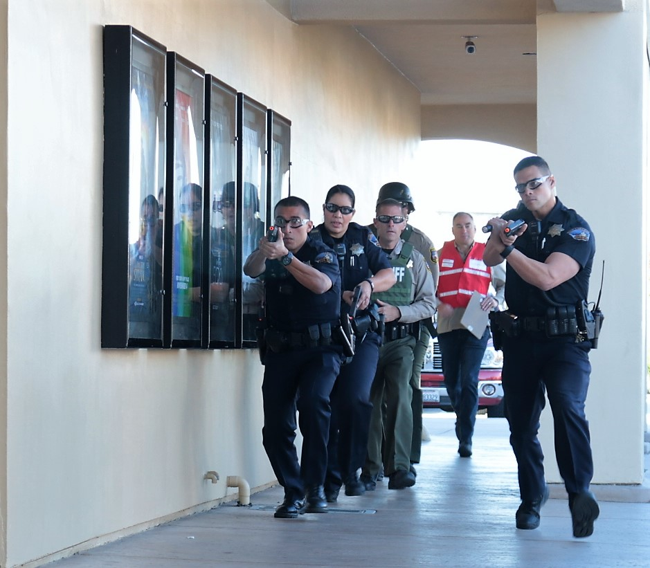Hollister first responders taking part in an active shooter drill. They drill regularly for crisis incidents. Photo by John Chadwell.