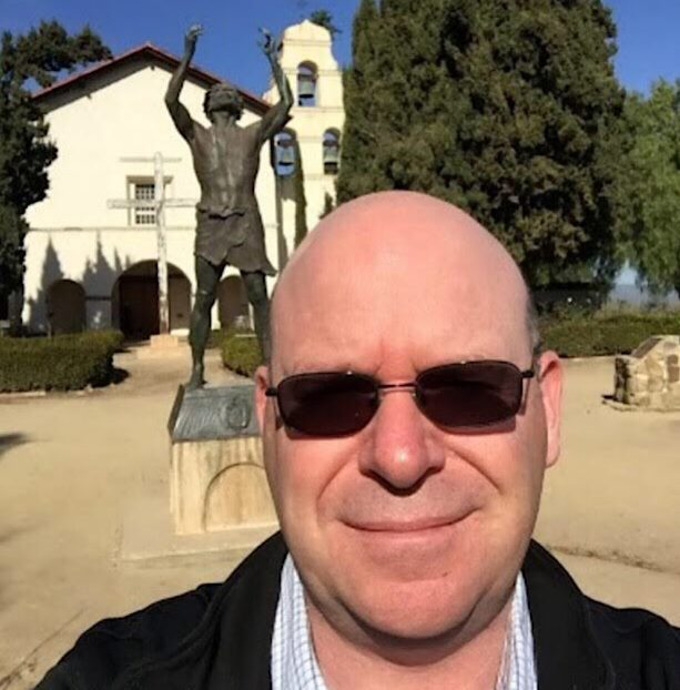 Christian Clifford in front of Mission San Juan Bautista during his mission walk. Photo courtesy of Christian Clifford.