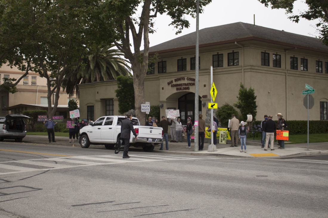 Members of San Benito Citizens for a Brighter Future and Preserve Our Rural Communities demonstrate outside the San Benito County Administration Building before a July 21 Board of Supervisors meeting. Photo by Noe Magaña.