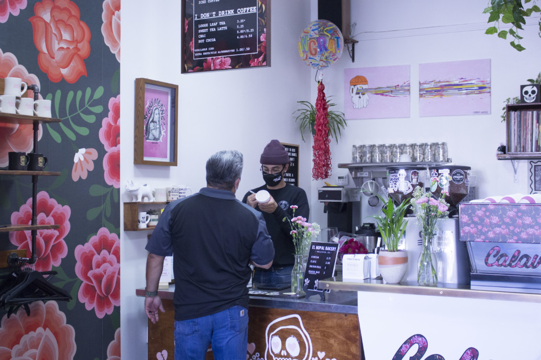 Calavera Coffee owner Evan Morris takes an order from a customer. Photo by Noe Magaña.