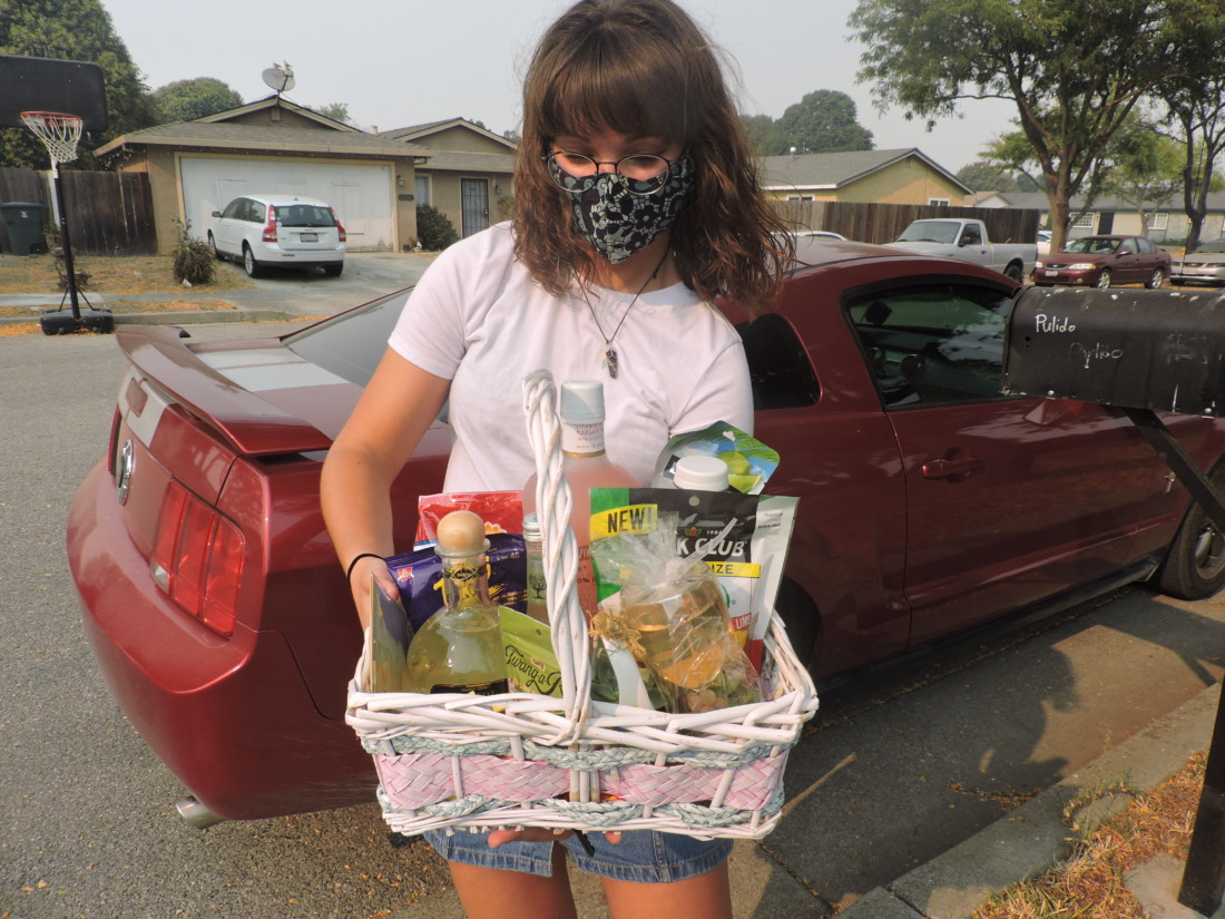Skylar Subia holds her first booze basket ready to deliver. Photo by Patty Lopez Day.