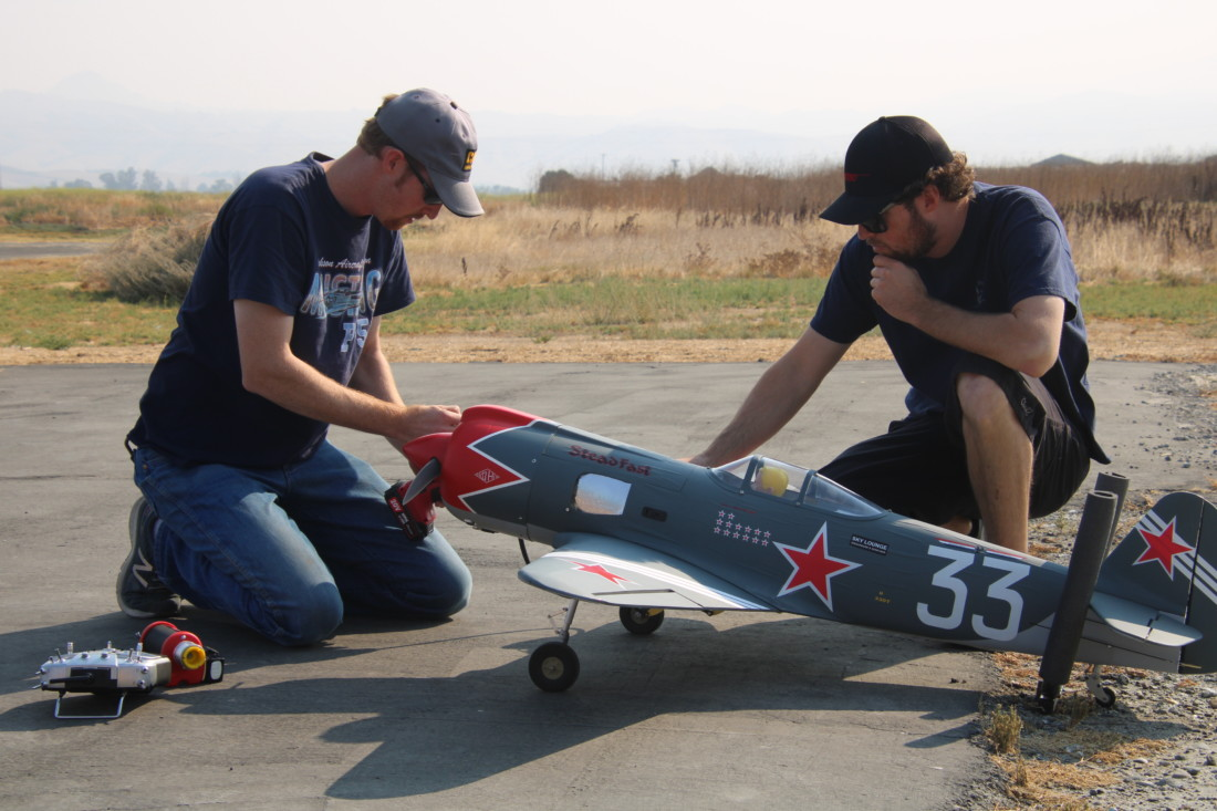 Rob Reed (left) readies his RC plane for flight. Photo by John Chadwell.
