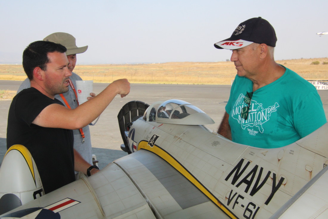Andre Torres shows Henri Richard the features of his new F9F Cougar. Photo by John Chadwell.