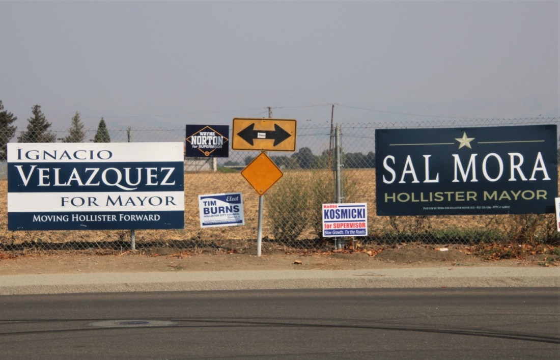 Campaign signs for mayor and other offices line the fence near Marguerite Maze Middle School. Photo by John Chadwell.